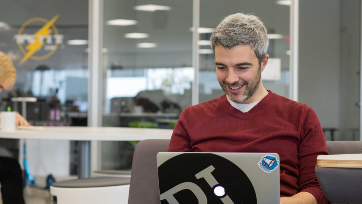 PI employee smiling while working