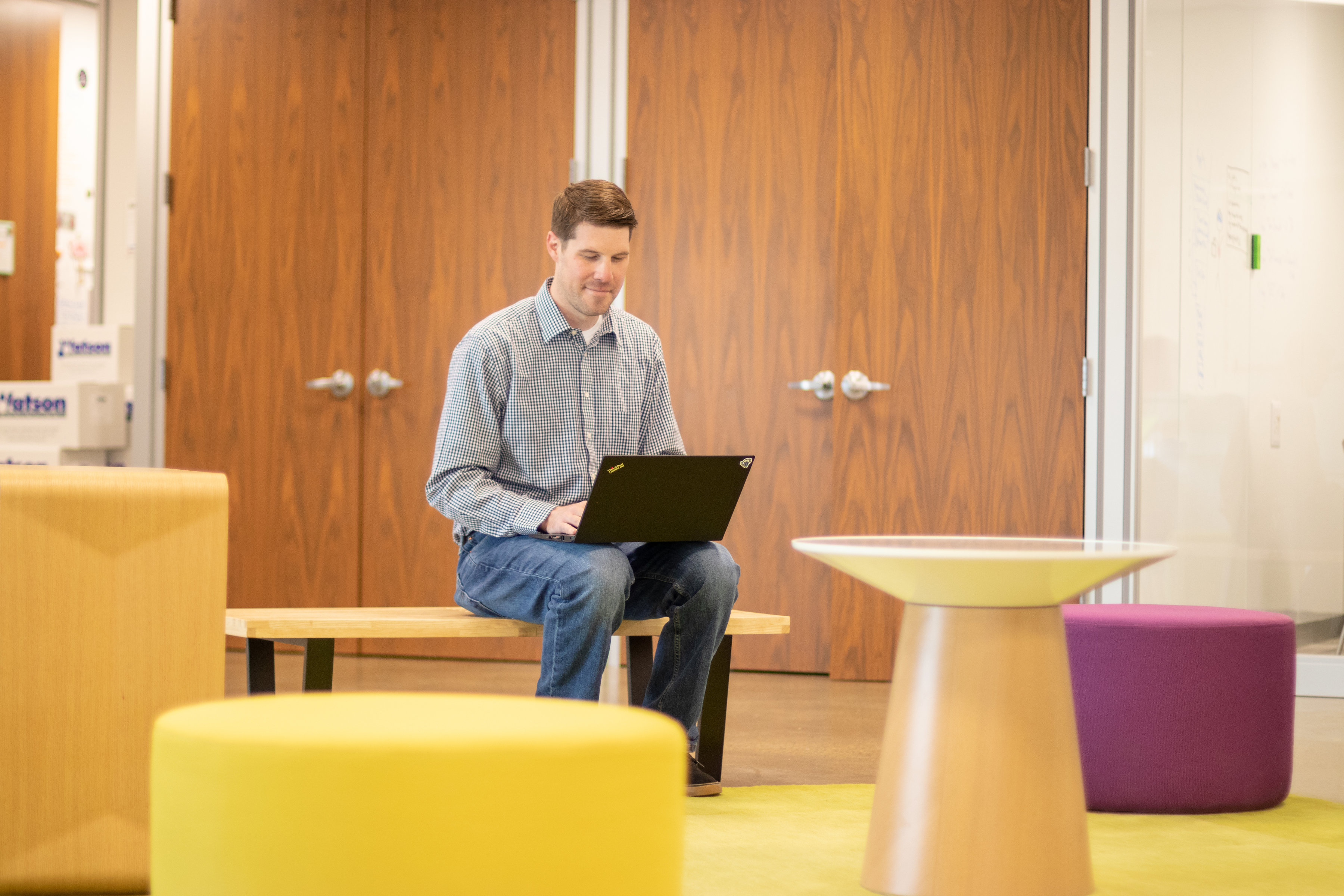 Disengaged employee in office on laptop