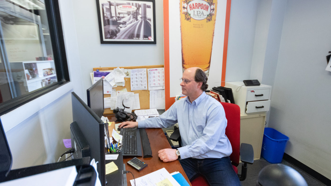 A manager sits at his desk
