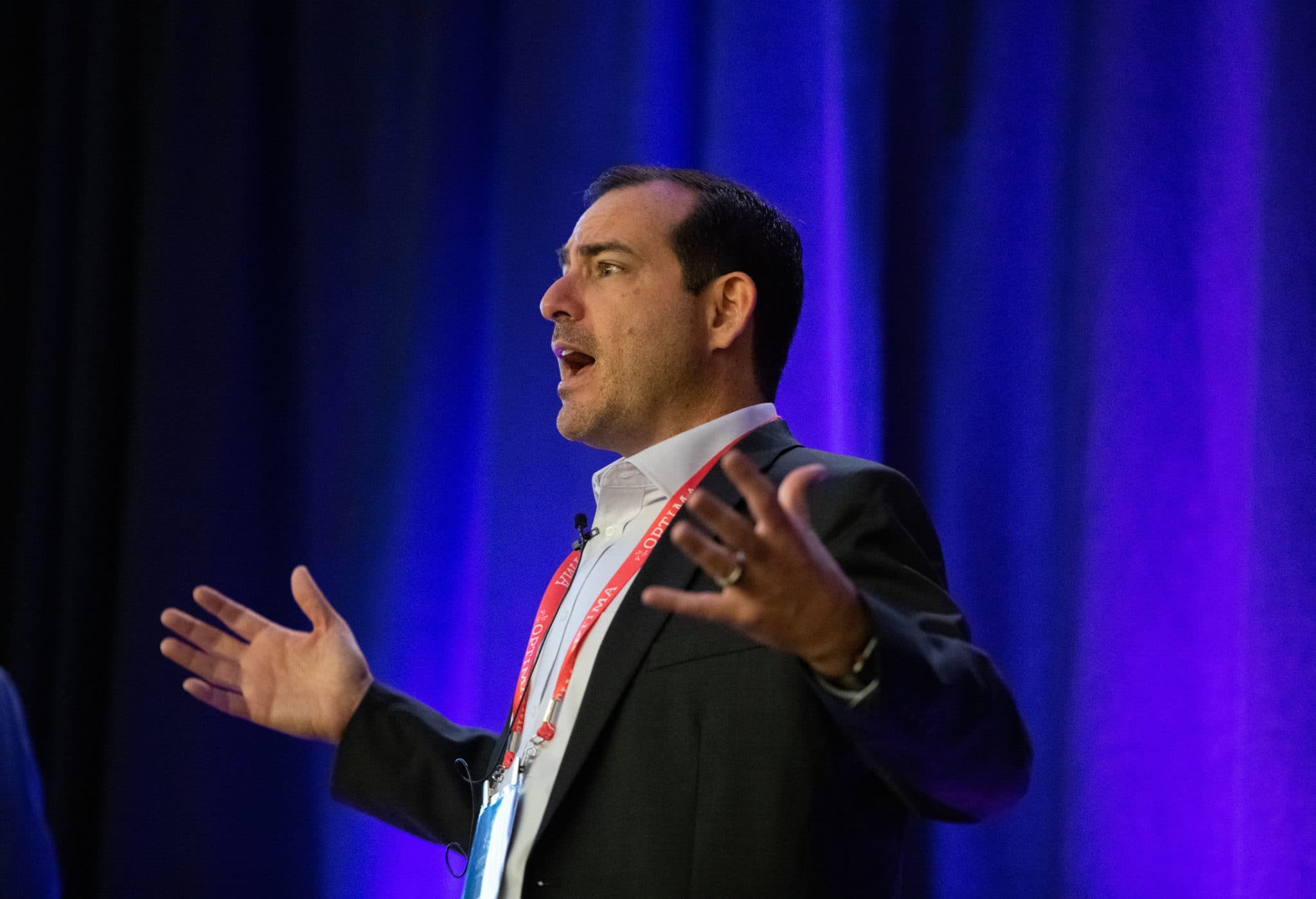 Dr. Greg Barnett speaking at the OPTIMA 2019 conference