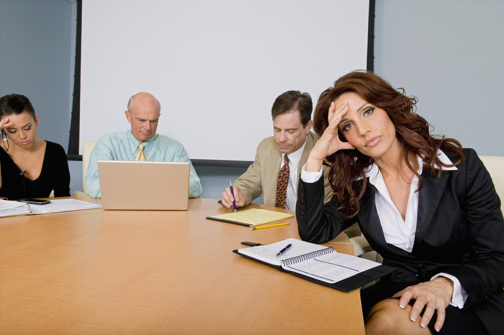 Woman bored in meeting