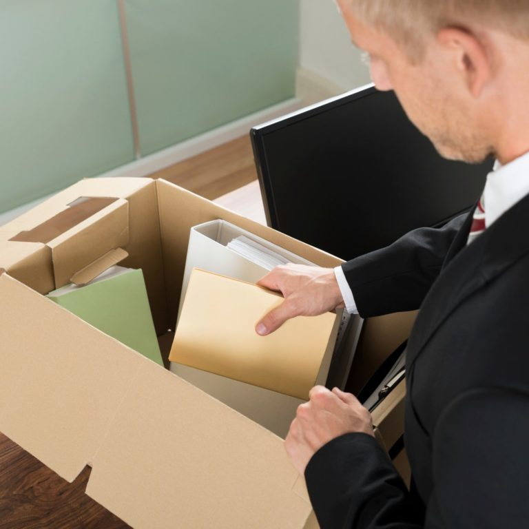 Employee packing up desk