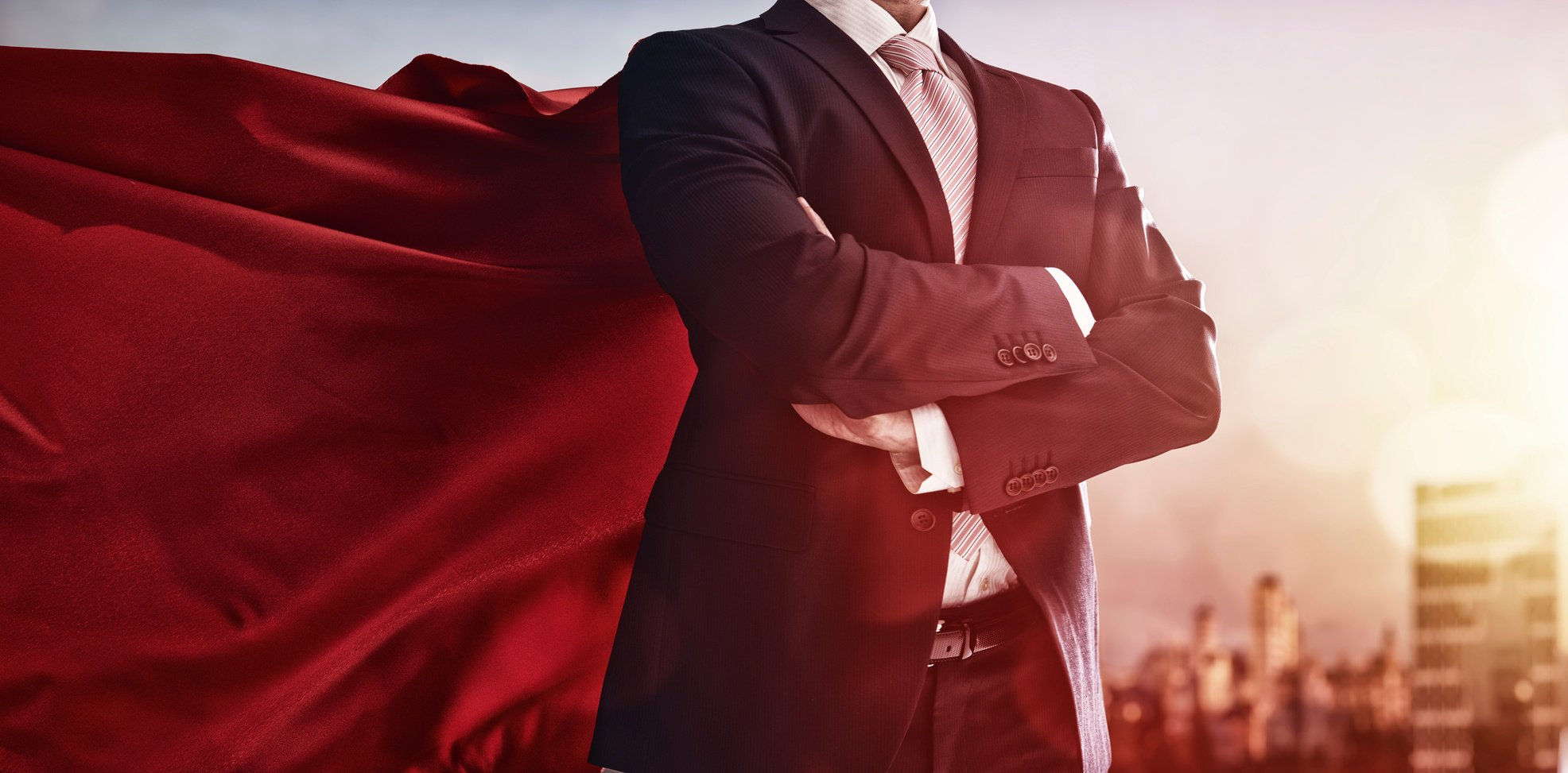 Business man in superhero cape