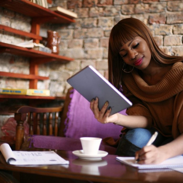 Woman working in cafe at remote job