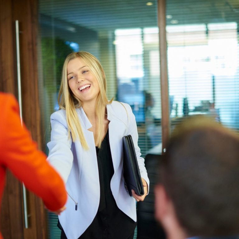 Woman walking into interview