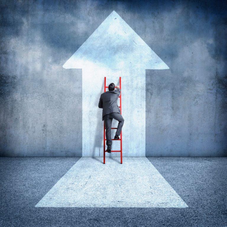 Man climbing ladder towards success
