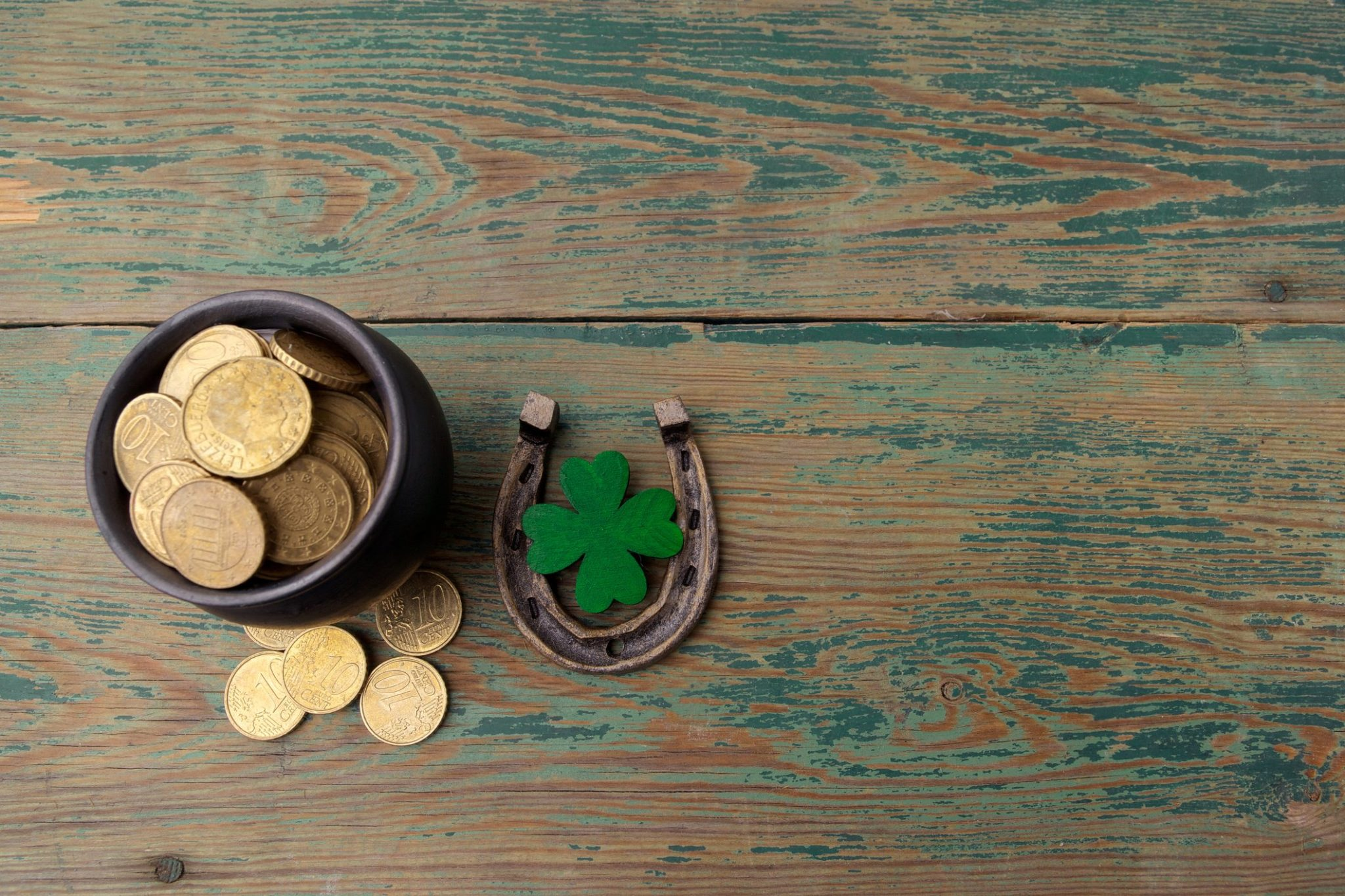 Gold coins, horse, and four leaf clover