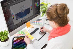 Employee creating logo on computer