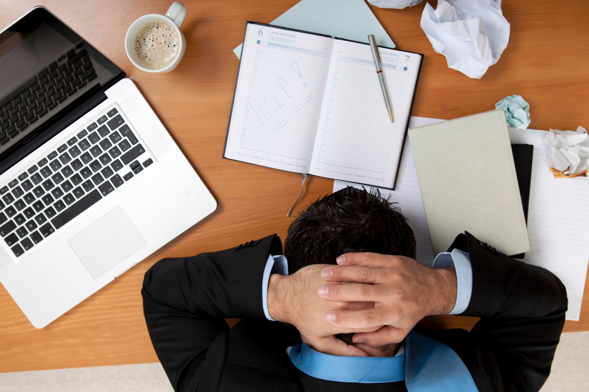 Employee with head down on desk