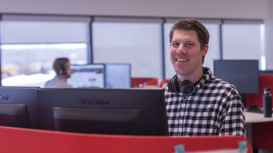 BDR employee at desk with headset