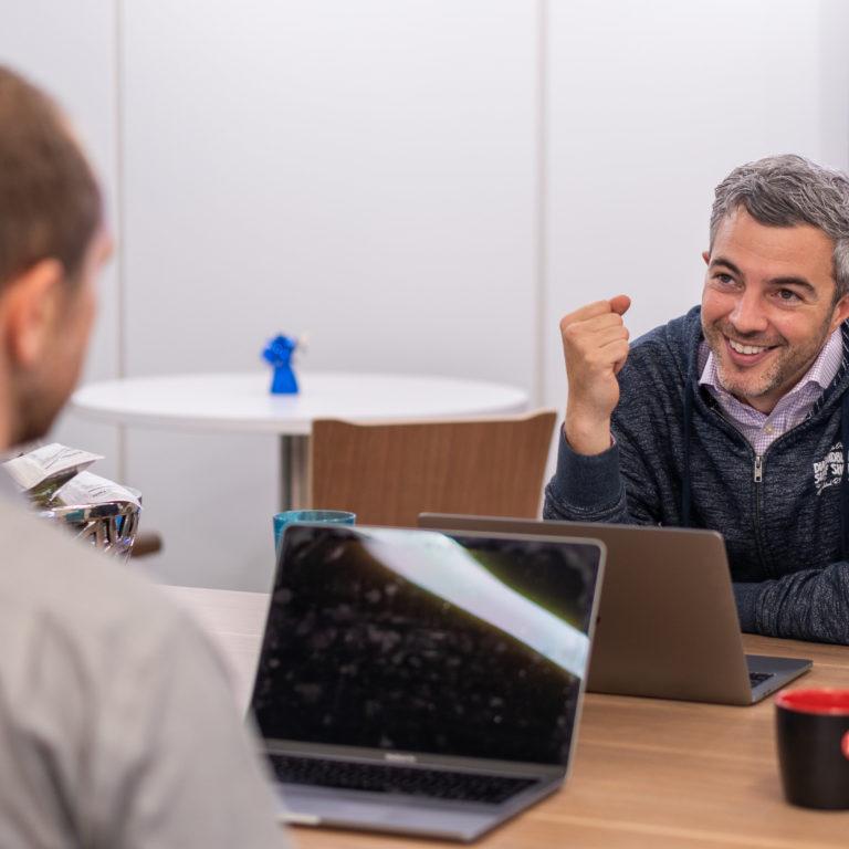A manager interviews a customer service employee