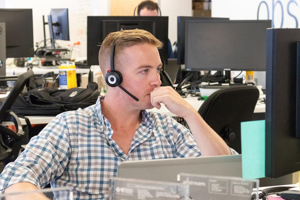 customer service rep at desk