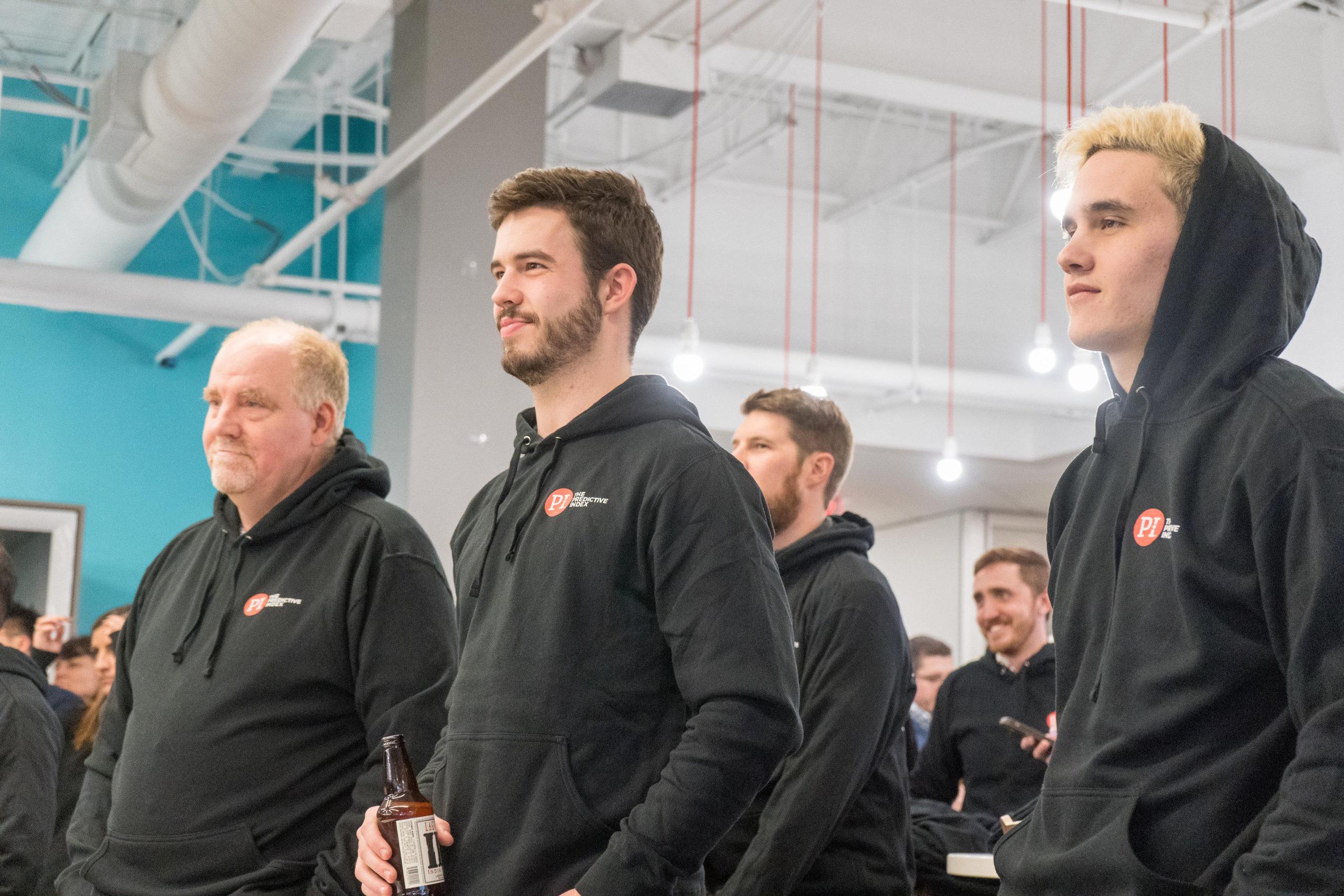 employees wear black hoodies