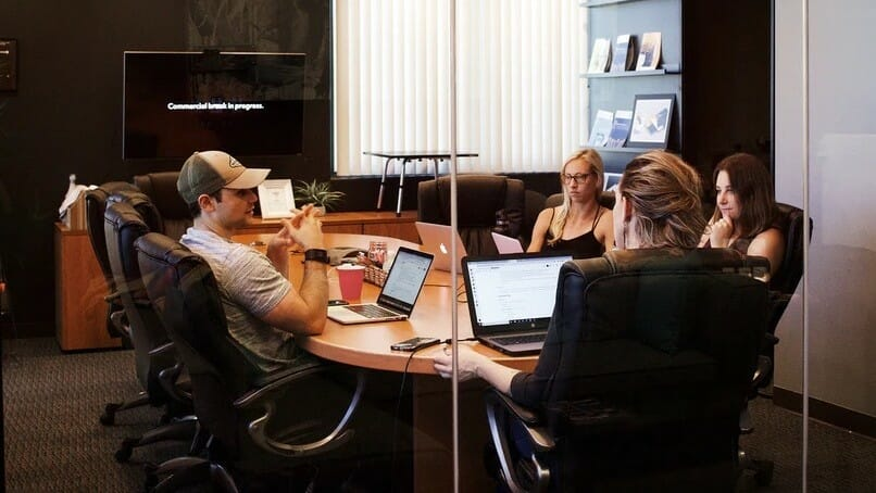 Employees in a hybrid team meeting